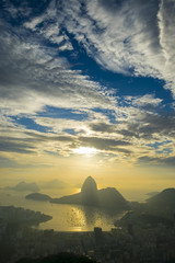Scenic Rio de Janeiro Brazil golden sunrise over Guanabara Bay with a misty skyline silhouette of Sugarloaf Mountain
