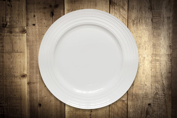 Empty White Plate over Rustic Timber