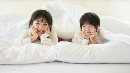 Cute asian children lying
