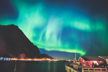 Beautiful picture of massive multicoloured vibrant Aurora Borealis, Aurora Polaris, also know as Northern Lights in the night sky over Norway, Lofoten Islands
