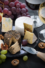 Assorted soft delicacy cheeses and appetizers to wine, vertical
