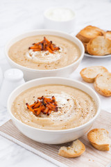 cream soup with caramelized carrots, vertical