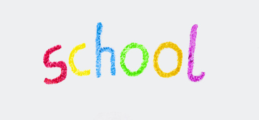 School in bright colorful wax crayon letters, for teaching.