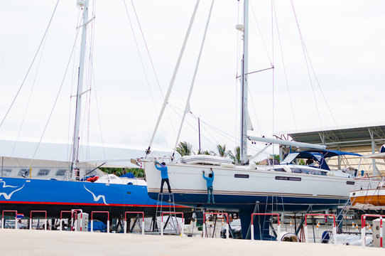Luxury sailboat on a maintenance process in a shipyard