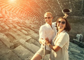 Happy young couple take self photo in their vacation