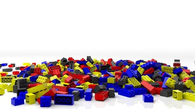 Pile of colorful lego blocks, isolated on white background.