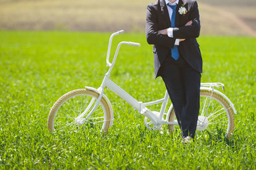 Man with Bicycle in Field