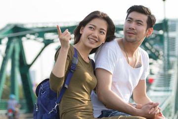 couples of younger asian man and woman relaxing with happy face