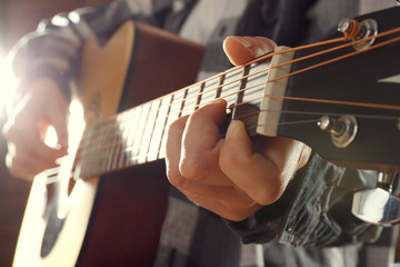 Close up view on playing guitar