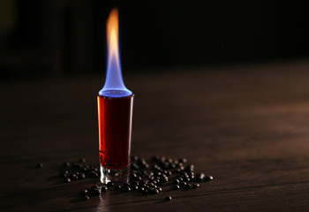 Burning cocktail and coffee beans on a table