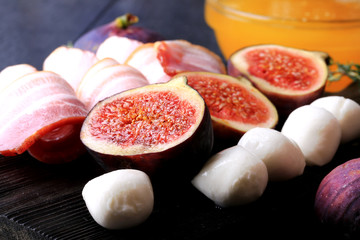 figs appetizer bacon mozzarella selective focus