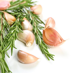 Garlic with rosemary isolated on white