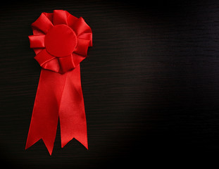 Award ribbons on dark wooden background