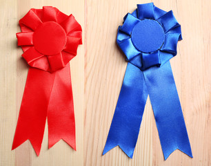 Award ribbons on wooden background