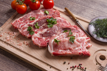 Fresh raw pork chop meat on cutting board