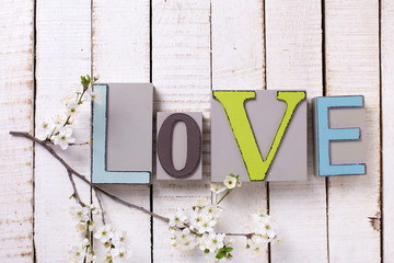 Word love and flowering branch of tree