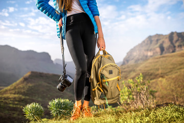 Traveler with photocamera and backpack