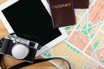 Sunglasses, passports, Digital tablet and map, close up. Preparing for travel concept