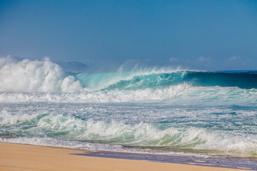Surfing waves at Bonzai Pipeline on the North Shore of Oahu, Hawaii
