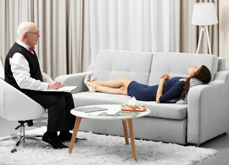 Young woman lying on sofa on reception at psychologist
