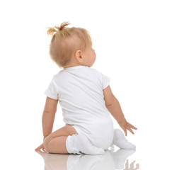 Infant child baby toddler sitting backwards back wiev and lookin