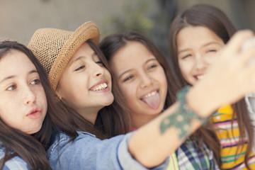 Happy girls taking a self portrait