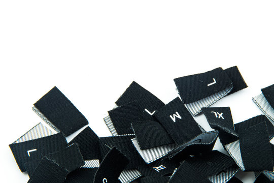 black fabric clothing size labels