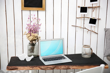 Modern workplace for designer on brick wall background