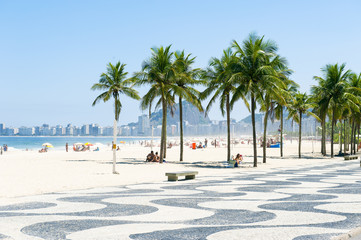 Scenic view of Copacabana Beach with palm trees at the Leme end of the beach in Rio de Janeiro, Brazil