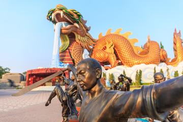 Bronze statue of Shaolin warriors monk at Dragon descendants Museum