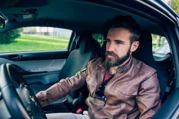 young handsome caucasian brown hair bearded man sitting on his c
