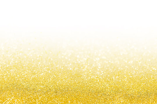 gold glitter texture christmas abstract background with white background fading up away