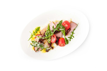 Salad with smoked ham and arugula in the white background horizontal