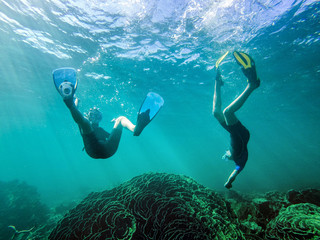 Boy and girl swimming underwater, Exmouth, Western Australia, Australia