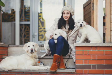 Portrait of the young woman with favourite dogs