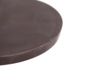 Round chocolate bar isolated on white background