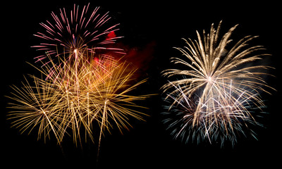 A variety of colorful fireworks isolated on black background