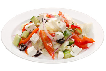 Greek salad. Olives, cheese and vegetables: pepper, cucumber, onion, cabbage on a white plate on a white background