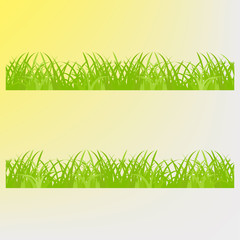 Green grass on a yellow background