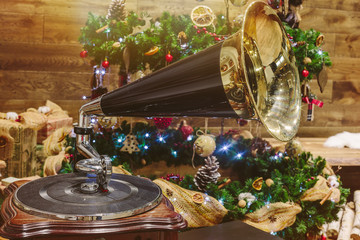 Music on New Year. Christmas tree, gramophone and decoration