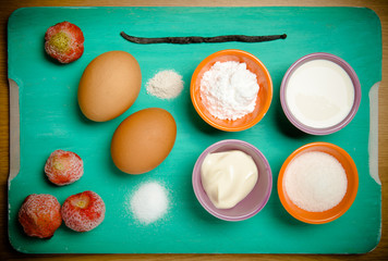 Ingredients for sweet pastry on a blue wooden cutting board. Sel