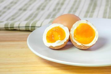 half medium-boiled eggs on white dish