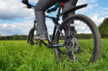 bicyclist riding a mountain bike in countryside