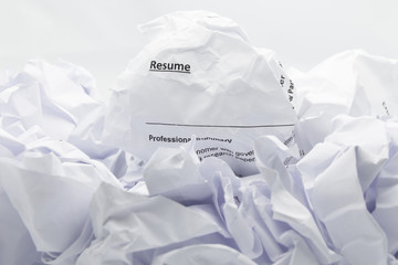 Resume crumpled up and thrown away in the trash.