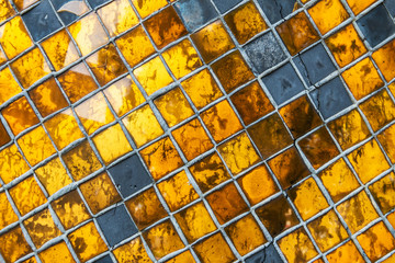 Wall Mural - Closeup of the old and weathered gold mosaic