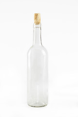 Empty glass bottle with cork isolated on white background