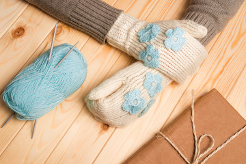 Knitted mittens with decorations and Christmas gift