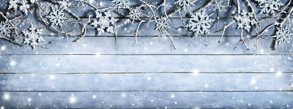 Winter Branches On Wooden Plank With Snowflakes