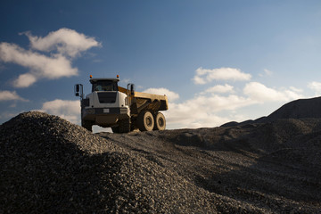 Dump Truck on the Pile of Gravel