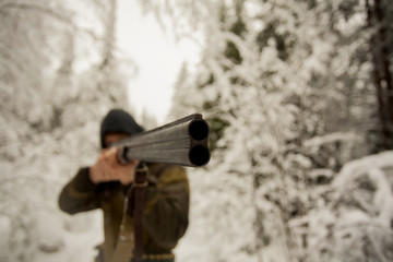 Hunter Pointing a Gun